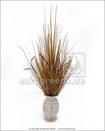 künstliches Gras-Arrangement mit Keramik Vase